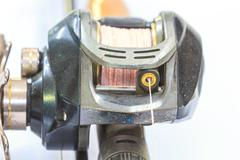 close up Baitcasting reel - stock photo