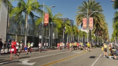 Participants in the LA Marathon Run Down Rodeo Drive  	 Stock Footage