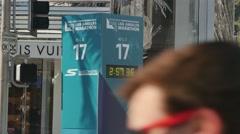 LA Marathon Participants Run Past Mile 17 Race Clock   Stock Footage