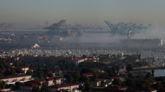Time lapse of Marine layer morning fog, ships and dock cranes at Long Beach Port Stock Footage
