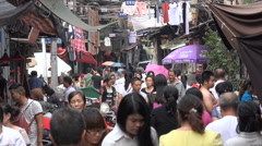People walk through busy alley in old traditional part of Wuhan, China Stock Footage