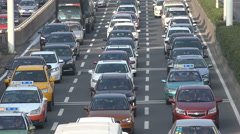 Slow driving traffic during rush hour on highway in Wuhan city, China Stock Footage