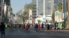 LA Marathon Participants Run Down Wilshire Boulevard  	 Stock Footage
