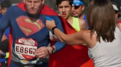 Racers Get Cooled Off while Running in the LA Marathon   Stock Footage