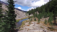 Aerial view of river passing through mountain and forest Stock Footage