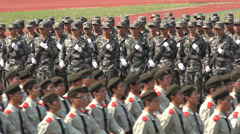 China military, students march during army parade at university Stock Footage