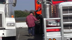 Truckers and truck rest stops, big truck big man Stock Footage