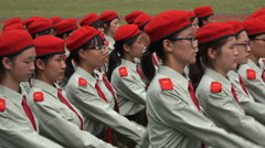 Chinese female students wear army uniforms during military parade - stock footage