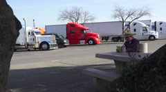 Truckers and truck rest stops ,reading from tablet Stock Footage