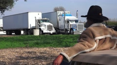 Truckers and truck rest stops , black man on break Stock Footage