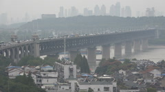 Heavy traffic drives over a bridge, severe smog in Wuhan, air pollution in China Stock Footage