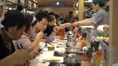 Noodles, dumplings, rice, and other dishes on offer, food court in South Korea Stock Footage