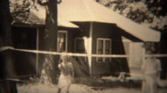 1936: People throwing floppy frisbee disc over badminton net. TRYON, NC Stock Footage