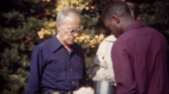1944: African waiter serving food to caucasian guests at autumn party. TRYON, NC Stock Footage
