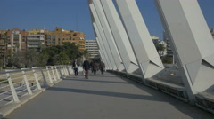 People walking on Alameda bridge in Valencia Stock Footage