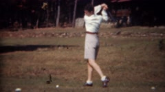 1945: Woman missing golf ball practice swinging with gray shorts. TRYON, NC Stock Footage