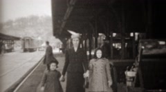 1941: Mother arrives at railroad train station holding daughters hands. TRYON, - stock footage