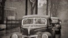 1941: Heavy winter snowstorm causes car breakdown and traffic backup. TRYON, NC Stock Footage
