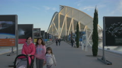 Walking by the advertising billboards in the City of Arts and Sciences, Valencia Stock Footage