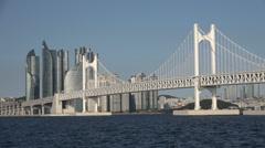 Modern skyline, bridge, office towers, residential apartments, Busan, Korea Stock Footage