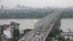 Hanoi skyline and smog, traffic drives over bridge, infrastructure in Vietnam - stock footage