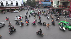 Busy traffic intersection in downtown old Hanoi city, urban Vietnam Stock Footage