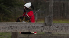 Historical reenactment. Medieval female knight preparing to battle with enemies Stock Footage