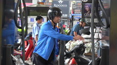 Gasoline petrol station, motorbikes, transportation, industry, Vietnam, Asia - stock footage