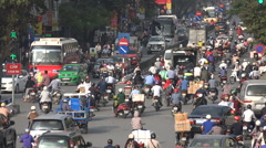 Chaotic traffic scene on a road in Hanoi, infrastructure transportation Vietnam - stock footage