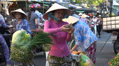 Local woman buying fresh vegetables at colorful Asian market, Vietnam Stock Footage