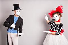 Your text here.  Colorful studio portrait of mimes with gray background. April Stock Photos