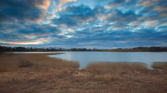 4k timelapse of after sunset cloudy sky over lake at springtime Stock Footage