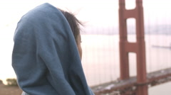 Portrait of alternative ethnic girl looking at scenic view of Golden Gate bridge Stock Footage