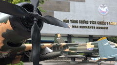 Vietnam War, old US airplane on display at museum in Saigon Stock Footage