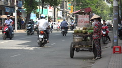 Local street vendor selling fresh coconut juice on roadside in Saigon, Vietnam Stock Footage