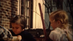 1937: Girl rolling dice in cup playing game with girlfriend outdoor summer. Stock Footage