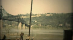 1936: Unemployed depression era derelict men hanging out under a bridge. TRYON, - stock footage