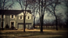 1937: Colonial style architecture modern house in wooded rural country.  TRYON, Stock Footage