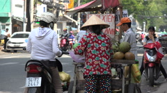 Buying fresh coconuts from a street vendor in Vietnam, Southeast Asia Stock Footage