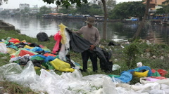 Asia recycling garbage, plastic sheets, poverty, suburbs of Saigon Vietnam Stock Footage