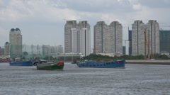 Urbanization in Vietnam, apartment buildings arise along the Saigon river - stock footage