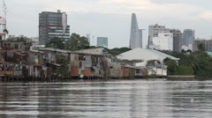 Contrast in third world city, slum housing and modern office buildings, Vietnam - stock footage