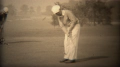 1938: Golfer in white outfit putting closeup on country club green. TRYON, NC - stock footage