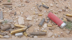 Various Gun Ammunition Shells on the Ground Stock Footage