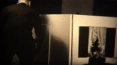 1937: Man visits wealthy daughters lifesize playhouse with realistic windows. Stock Footage