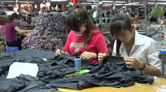Quality control department in Asian garment factory - stock footage