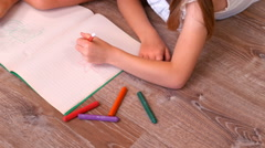 Sibling drawing together in living room Stock Footage