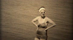 1938: Women in white round sunglasses and old timey bathing suit. TRYON, NC Stock Footage