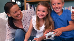 Family playing video game Stock Footage