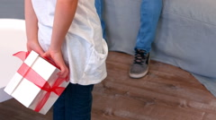Daughter hidding present for father Stock Footage